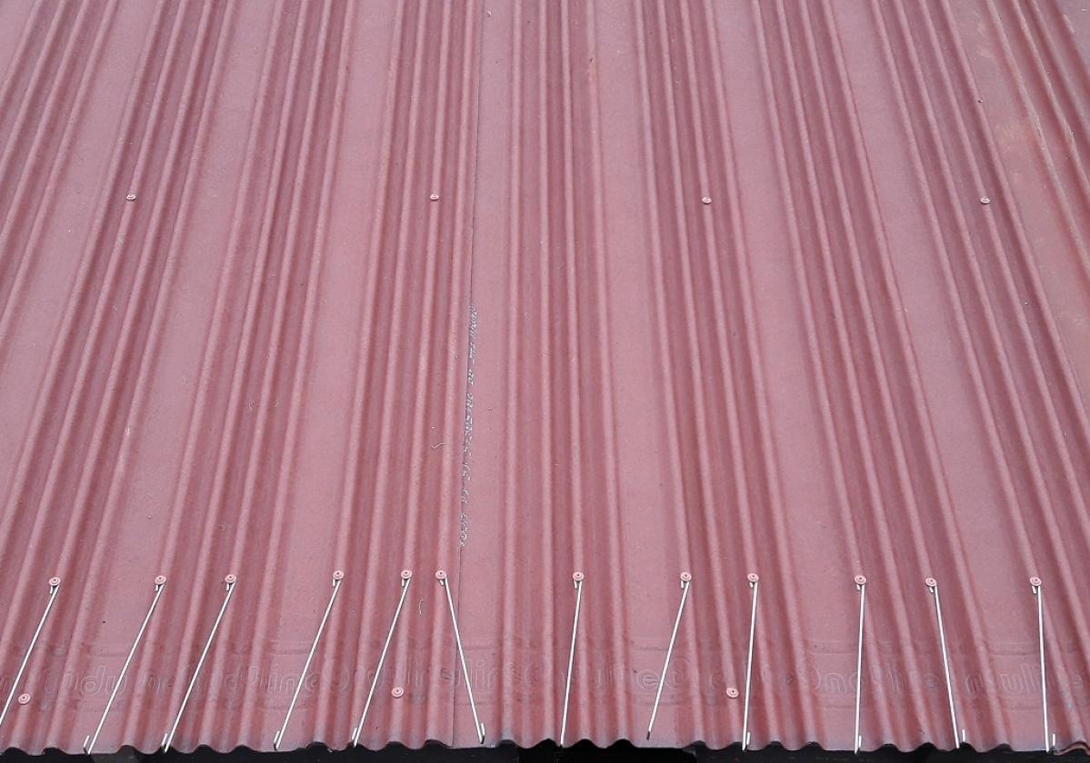 Gancho teja curva remate alero tejado ventilado impermeabilización tejado Onduline Bajo Teja - detalle instalación